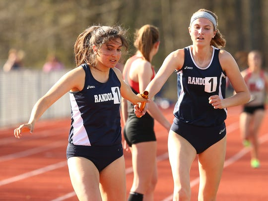 Randolph's Meredith Finley hands off to Brooke Olson during the girls  4 x 1600m final at the Morris County Relays at Randolph High School. May 2, 2018. Morristown, NJ