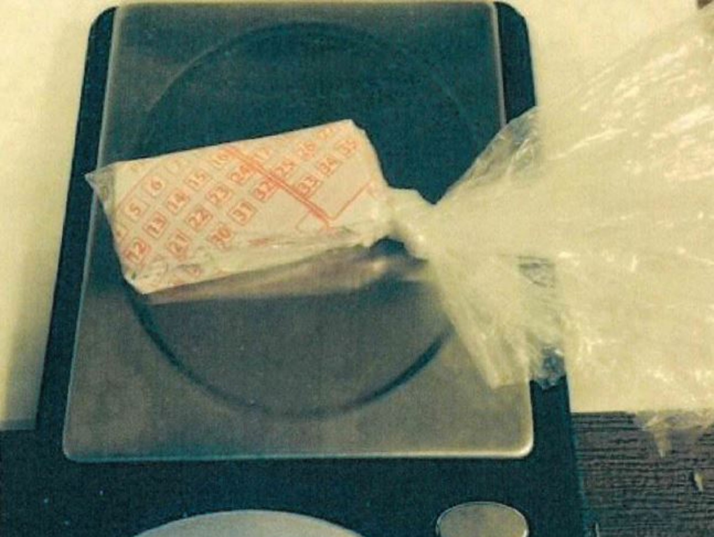 Suspected heroin wrapped in a lottery slip.