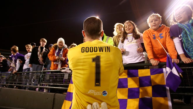 Louisville City FC's keeper Scott Goodwin spends time with the fans after their win. Oct. 3, 2015