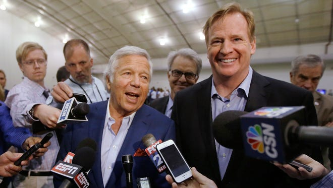 In this May 29, 2014, file photo, NFL commissioner Roger Goodell, right, and Patriots owner Robert Kraft address members of the media during a football safety clinic for mothers at the team's facilities in Foxborough, Mass.