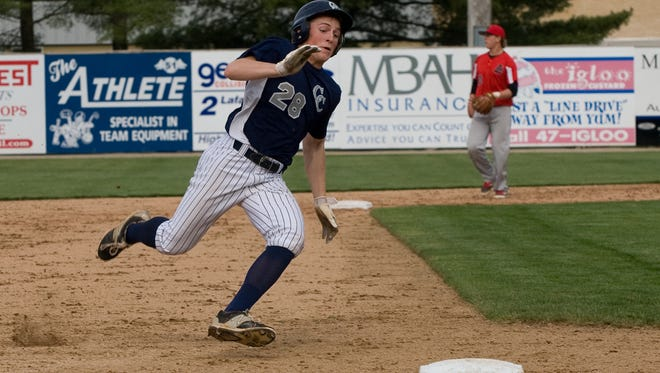 Central Catholic's Ben Metzinger rounds third base and scores on Tyler Powers' single in the second inning.