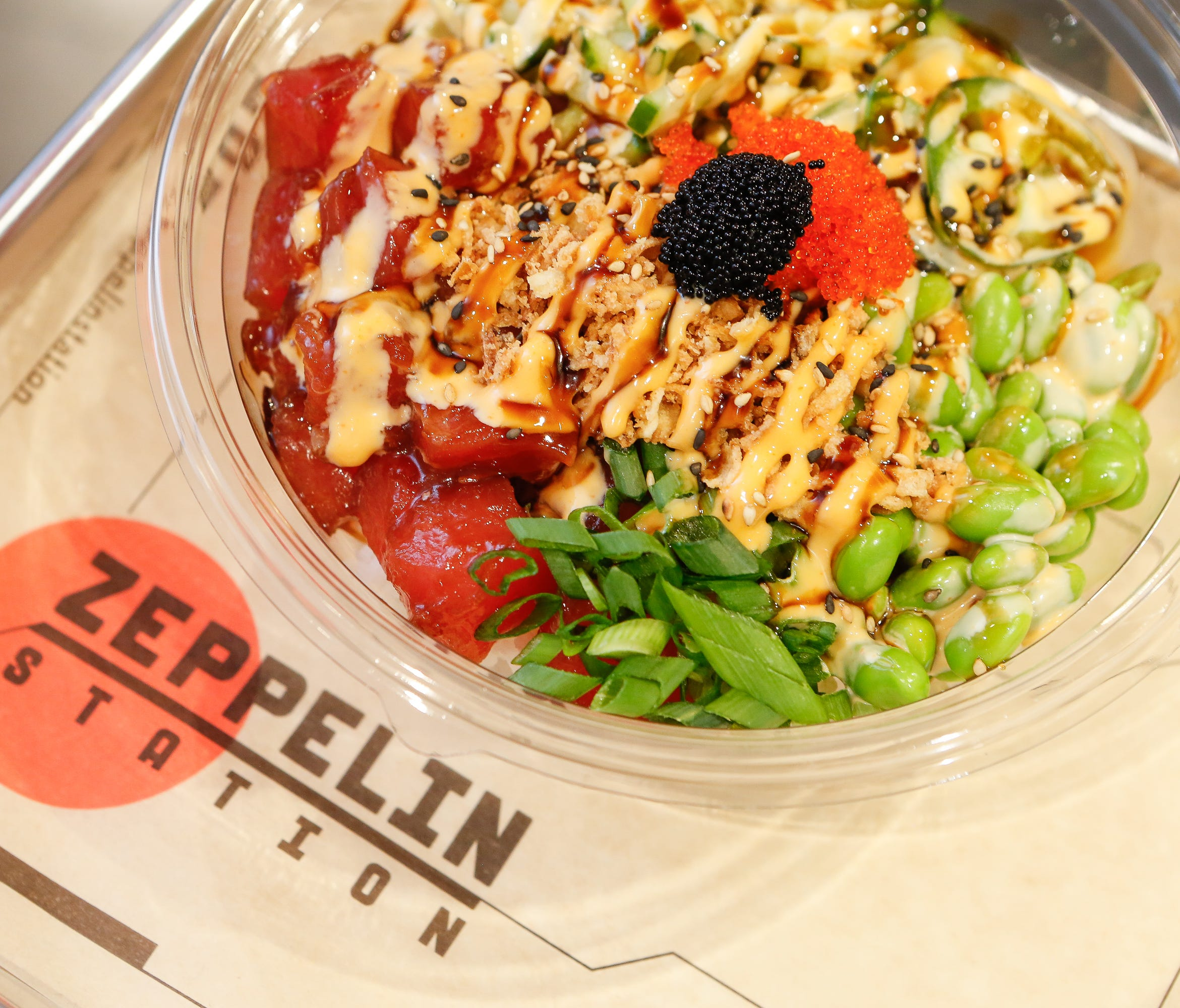 Aloha Poke offers three sizes, three bases and endless combinations of toppings (including vegetarian options).