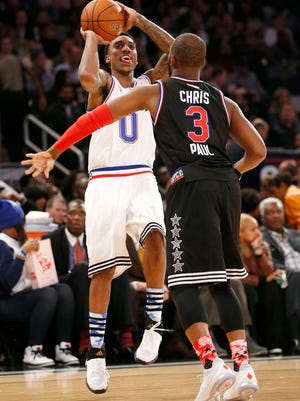 East TeamÕs Jeff Teague, of the Atlanta Hawks, shoots agains West TeamÕs Chris Paul, of the Los Angeles Clippers, during the second half of the NBA All-Star basketball game, Sunday, Feb. 15, 2015, in New York. (AP Photo/Kathy Willens)