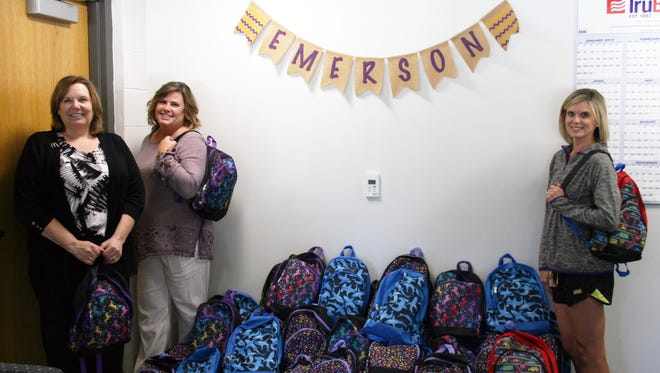 McDonald's donated 84 backpacks to Emerson Elementary in early September, just before school starts and the new restaurant opens in town. From left to right are McDonald's new owner, Toby Johnson, Cara VanSteenis, a communications liaison, and Jennifer Pribil, a guidance counselor at Emerson.