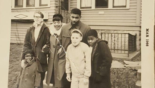 Joe McCarty, far left, and Chuck Holmes, middle right, pose for a photo outside a home in Milwaukee in 1966. Both were Kaukauna students who participated in a student exchange that year with Rufus King High School in Milwaukee.