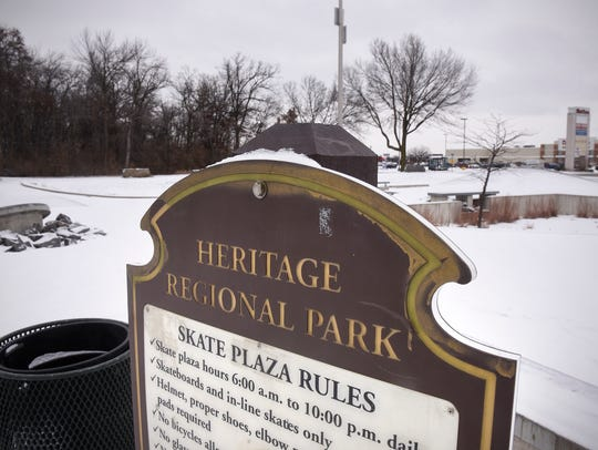 A sign announces the skate plaza rules at Heritage