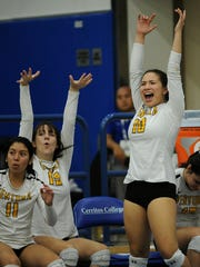 Brenda Orozco, from left, Carly Coffman and Jessica Valazquez cheer near the end of the game as Ventura High School girls won the 2016 CIF Southern Section Division ll Girls Volleyball Championship in Cerritos. The Cougars will now look ahead to state playoffs.