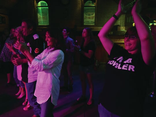 Fans show their approval for the July show Coyote Union performed at historic George's  Majestic Lounge in Fayetteville.