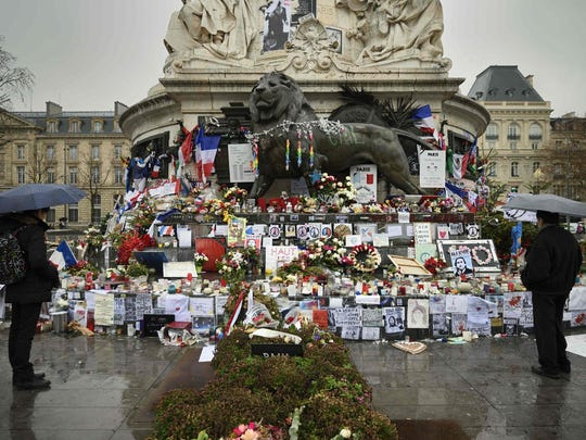 Parisians turn out for  a makeshift memorial for the