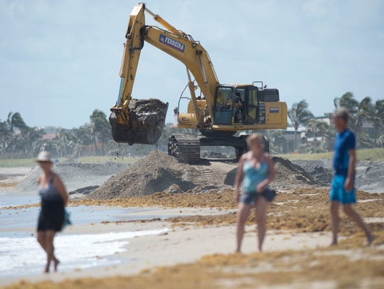 Construction crews work on renourishing Bathtub Reef Beach on April 20, 2017, at the beach on South Hutchinson Island.