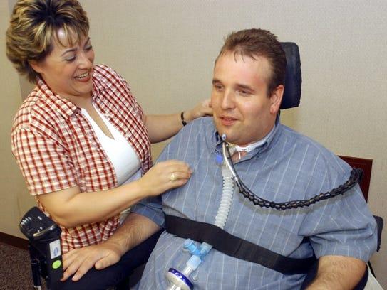 Melissa Deicher talks with her husband, Matt, at a