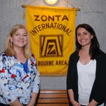 Nancy Peltonen, left, and Tiffany Cointepoix pose for a photo during the 2015 Zonta Club Chocolate Festival on Mar. 1 at the Eau Gallie Civic Center.