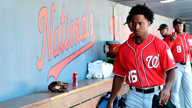 """""""No one's going to fill Bryce Harper's shoes,"""" Nationals GM Mike Rizzo says of Victor Robles, """"but this is a good young player for us and we have a lot of good young players,''"""