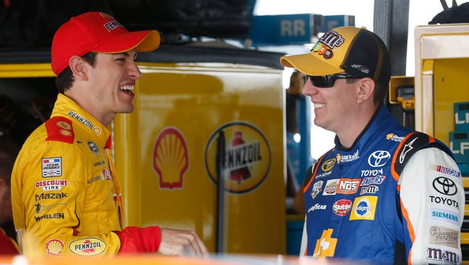 Joey Logano, left, and Kyle Busch are two of the members of the drivers' council that met Friday night at Talladega Superspeedway.