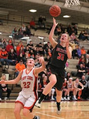 Buckeye Central's Kyleigh Brown makes a jump shot during