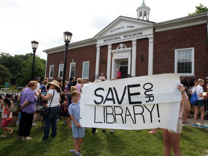 The Friends of the Watchung Library want to make a statement that the households of Watchung are willing to spend $1.30 for a new library/community center. They are asking as many children as possible to come with their $1.30 on June 27 at 10am to Watchung Borough Hall.     On Friday June 27,2014 Photo: Mark R. Sullivan/Staff Photographer