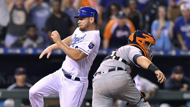 The Royals' Brandon Moss scores the winning run past Tigers catcher James McCann on a sacrifice fly by Alex Gordon in the ninth inning at Kauffman Stadium on July 19, 2017.