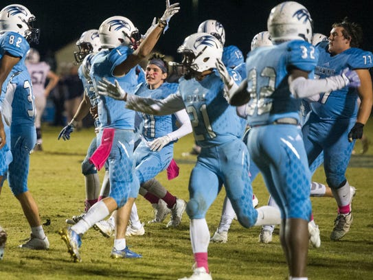 Hardin Valley celebrates after their 37-36 win over