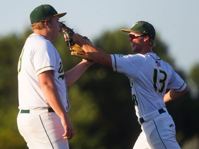 Iowa City West's Ryan Cooper jokes around with pitcher