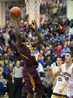 Mount Vernon's Gregory Calixte goes up for a shot in front of St. Anthony defenders during the consolation game of the SNY Invitational at the CCNY's Nat Holman Gymnasium in New York, Jan. 28, 2017.
