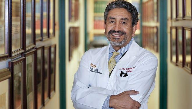 In an Aug. 10, 2017 photo, Dr. Omar Abubaker, professor and chair of Oral and Facial Surgery at VCU's School of Dentistry, poses for a photo in Richmond, Va..