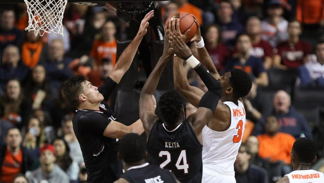 Syracuse guard Andrew White III (3) rebounds against South Carolina forwards Sedee Keita (24) and Maik Kotsar (21) during the second half.