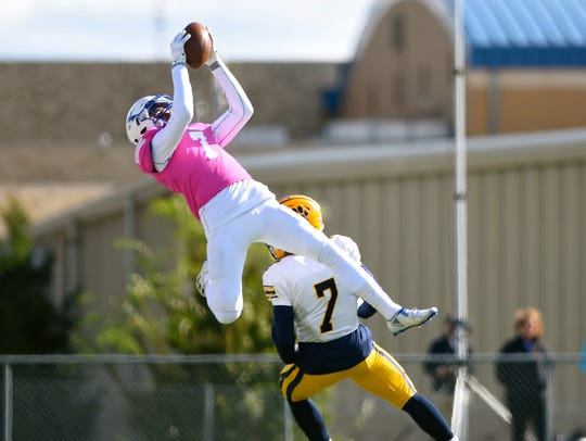 St. Xavier's Micah Farrar leaps for a ball in the second