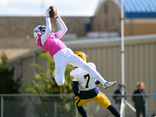 St. Xavier's Micah Farrar leaps for a ball in the second quarter against Cleveland St. Ignatius Saturday.
