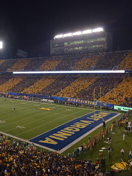big 12 football man jumps off wall during west virginia baylor game