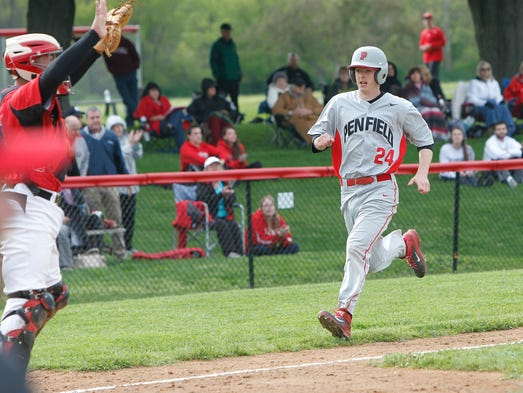 Penfield's Alex D'Agostino, right, heads home for a run during a 6-5 win over Hilton Friday.