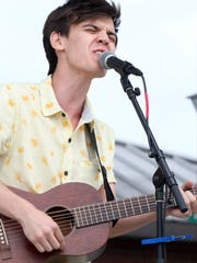 MacKenzie Bourg performs during St. Thomas More Catholic High School's ninth annual HopeFest to raise money for Healing House and STM's Options program for students with special needs Saturday, April 18, 2015, at Parc International in Lafayette, La.