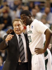 Michigan State University head coach Tom Izzo talks with Draymond Green during a break against USC  in the 1st half of their 2nd round game of the NCAA basketball tournament in Minneapolis, Minn. on Sunday, March 22, 2009.