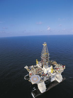 FILE - In this undated file photo released by Transocean, the ultra-deepwater semi-submersible rig Deepwater Horizon is shown operating in the U.S. Gulf of Mexico. Authorities were searching for missing workers early Wednesday April 21, 2010 who evacuated after an explosion at the oil drilling platform off the coast of Louisiana. The explosion happened around 10 p.m. Tuesday, 52 miles southeast of Venice, La., while 126 workers were aboard the platform, Coast Guard Senior Chief Petty Officer Mike O'Berry said. (AP Photo/Transocean) ** NO SALES **