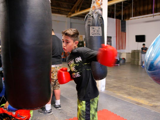 Danny Esquivas throws a punch at Rock Boxing Gym.