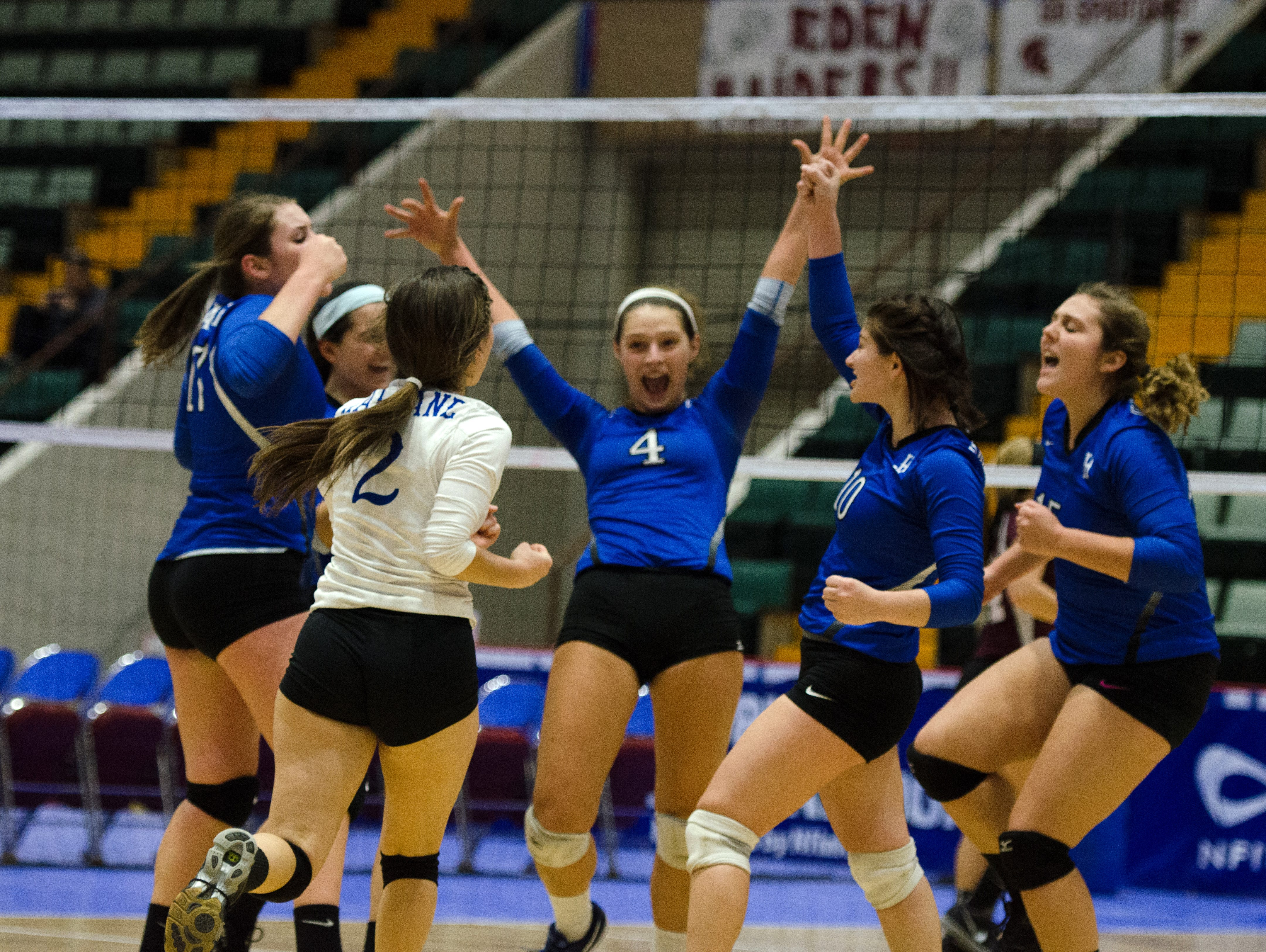 Haldane players come togther to celebtate after a scoring play during the Class D State Volleyball Finals Sunday November 22, 2015 at Glens Falls Civic Center.