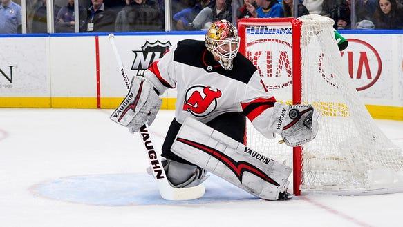 New Jersey Devils goaltender Keith Kinkaid (1) defends