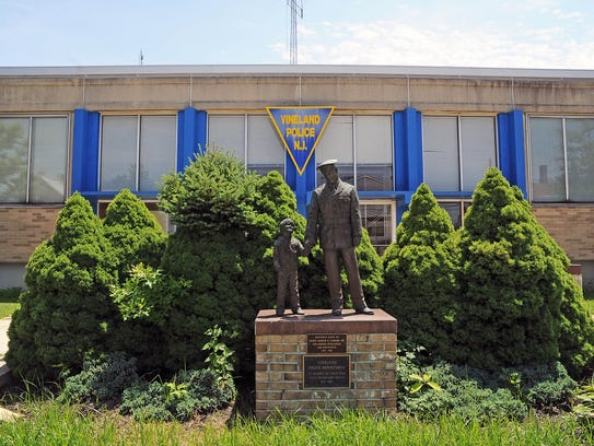 """""""The Protector,"""" a bronze statue of a police officer"""
