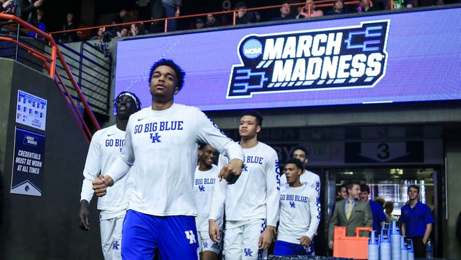 "Kentucky's PJ Washington flexes as the team enters the Taco Bell Arena court area before the game against Davidson.  ""You've got to play 40 minutes and fight like heck and then go back to the hotel room and pass out,"" Calipari said after the Wildcats' win over Davidson. March 15, 2018"