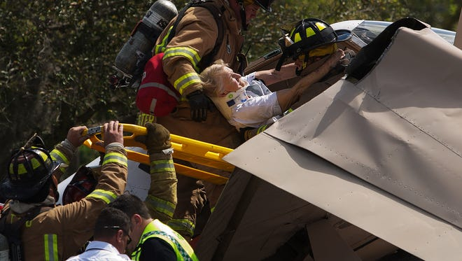 Donna Piehl, 85, an Estero resident is pulled from the wreckage of a plane that crashed in Fort Myers on Monday March 9, 2015.  Her son, Michael was the pilot.  Piehl would later succumb to her injuries.