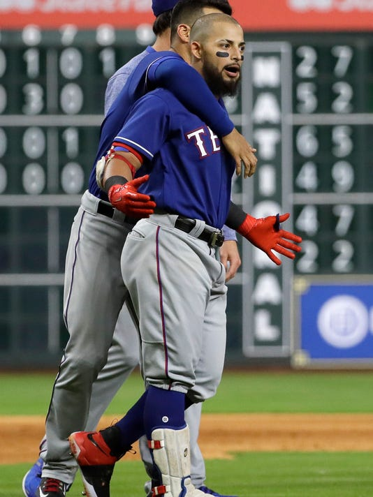 Texas Rangers second baseman Rougned Odor, right, is restrained by Robinson Chirinos after both benches cleared following a close pitch thrown by starting pitcher Lance McCullers Jr. to Mike Napoli during the sixth inning of a baseball game, Monday, May 1, 2017, in Houston. (AP Photo/David J. Phillip)