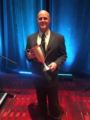 Matt Nein poses after winning the 2018 College Strength and Conditioning Coach of the Year award.