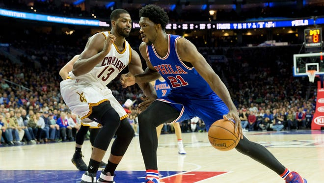 Sixers center Joel Embiid (21) dribbles past Cavaliers center Tristan Thompson during a 102-101 loss on Saturday.
