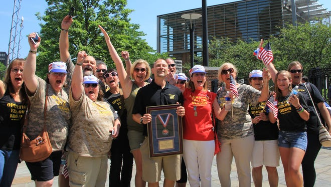 David Silver, president of Operation Yellow Ribbon of South Jersey, and other volunteers celebrate winning a competitive $50,000 grant from the Wawa Foundation for their  work. They send care packages to the military servicemen  in combat.