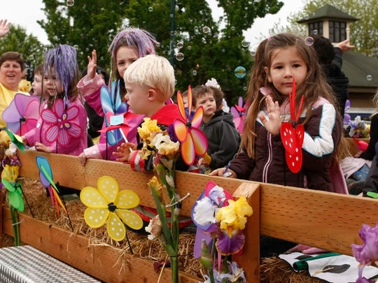 Children with the Salem Child Development Center wave during the Keizer Iris Festival Parade on Saturday, May 18, 2013.