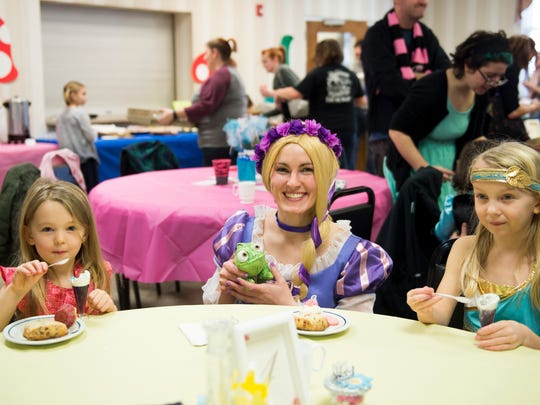 Princess Rapunzel joins Brynlee, 4, (left) and Ariana Nieberding, 7, for some sweet treats during a princess teatime hosted by the Black Rose Rollers at the Hanover YWCA on Saturday, Feb. 11, 2017.