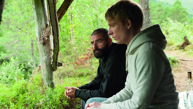 "Domhnall Gleeson, right, and Oscar Isaac appear in a scene from ""Ex Machina."""