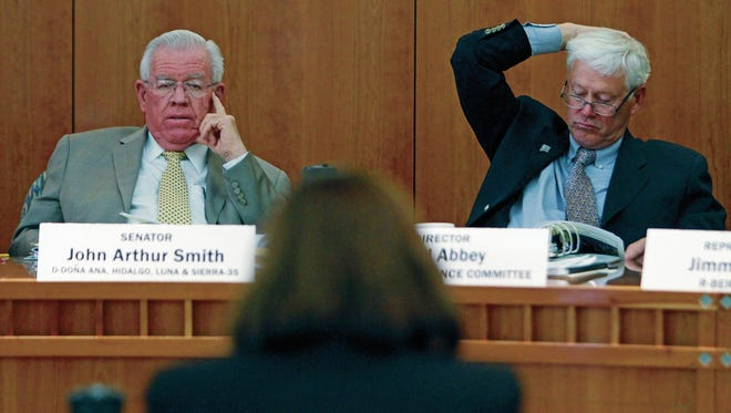 From left, Democratic Sen. John Arthur Smith and David Abbey, director of the Legislative Finance Committee staff, listen to testimony during a hearing last year at the New Mexico Legislature.