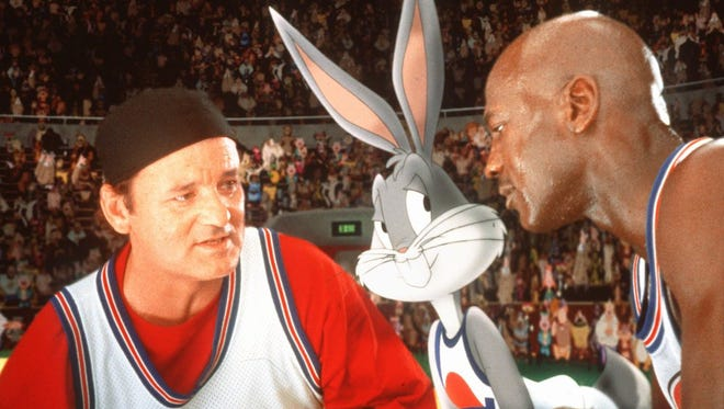 """Bill Murray, left, Bugs Bunny, and Michael Jordan are shown in a scene from the Warner Bros. film """"Space Jam,"""" in this handout photo."""