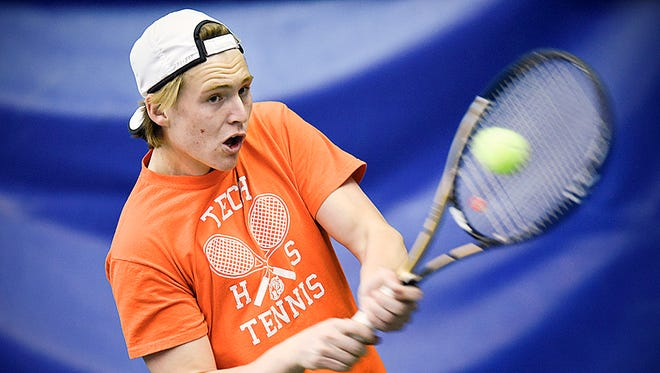 St. Cloud Tech's Riley Peterson returns the ball while playing tennis Tuesday at Fitness Evolution in Sartell. Peterson is in his sixth and final season on the Tech varsity tennis team.