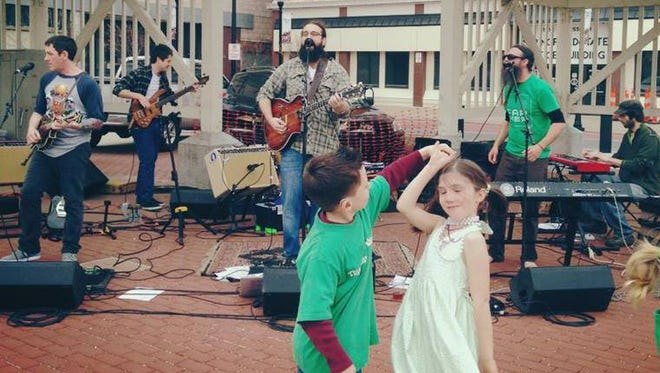 The musicians of the Shotgun Brothers Band, who will perform at the Peachtree Music Festival, encourages children to join the fun.